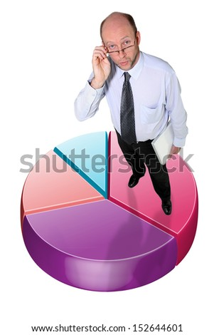 Businessman standing on a graphic pie chart - stock photo