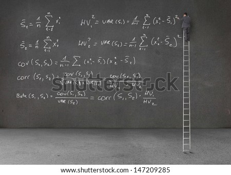 Businessman standing on a ladder and writing maths equations