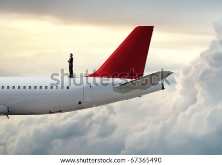 Businessman standing on a plane - stock photo