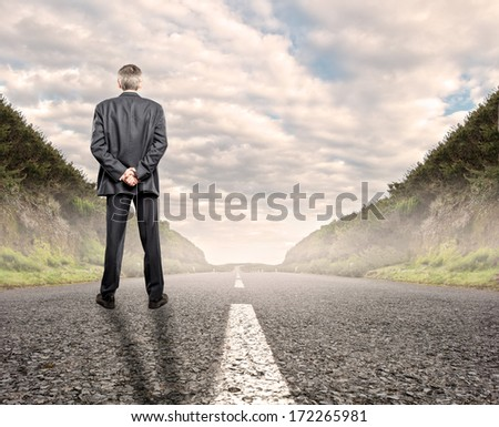 businessman standing on a road. - stock photo
