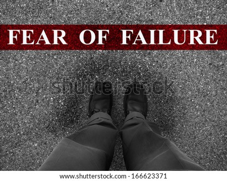 Businessman standing on asphalt starting line with word fear of failure - stock photo