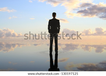 businessman standing on background of nature - stock photo