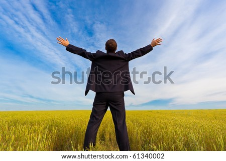 businessman standing on field