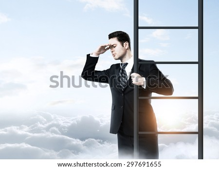 businessman standing on ladder and looking to sky - stock photo