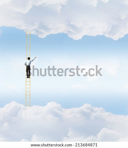 Businessman standing on ladder high in sky - stock photo
