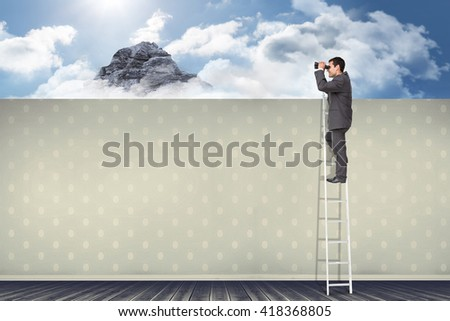 Businessman standing on ladder using binoculars against room with wooden floor - stock photo