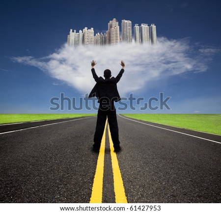 businessman standing on the empty road and watching the future city on the cloud - stock photo