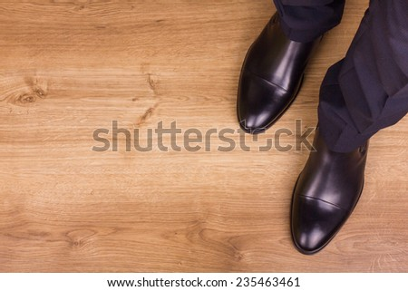 Businessman standing on the floor in polished shoes