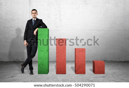 Businessman standing on the floor next to large green and three smaller red columns of a graph, Business and management. Statisics and data. Successful people.