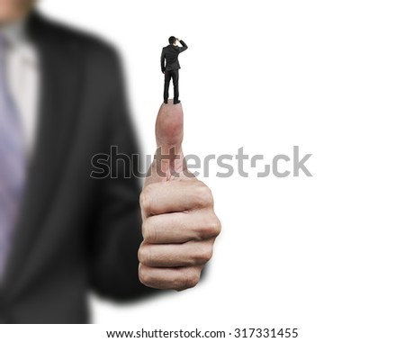Businessman standing on top of another big thumb, with white background. - stock photo