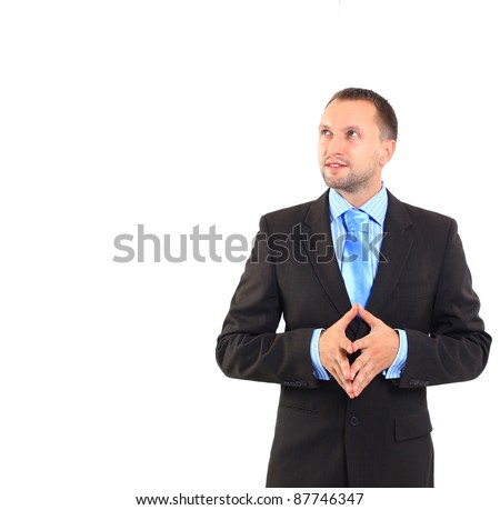 Businessman standing on white background, looking off into distance - stock photo