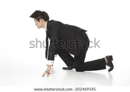 Businessman standing on white wallpaper