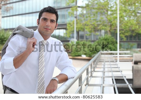 Businessman standing outside - stock photo