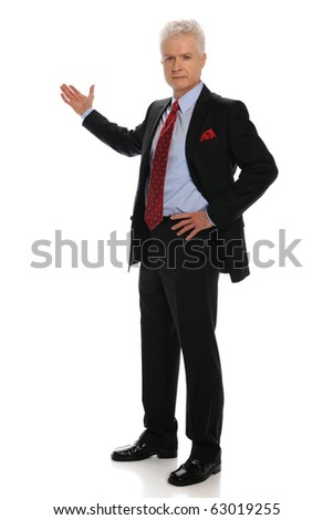 Businessman standing pointing with his right hand isolated on a white background