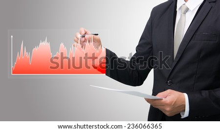 Businessman standing posture hand hold a pen isolated on gray background