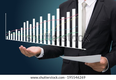 Businessman standing posture hand holding graph finance isolated on dark background