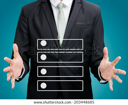 Businessman standing posture hand holding strategy flowchart isolated on over gray background - stock photo