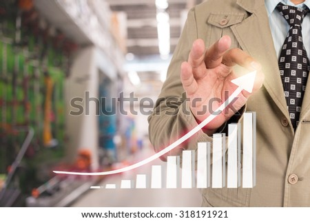 Businessman standing posture hand touch financial symbols coming
