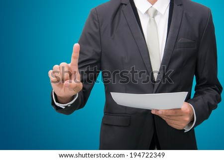 Businessman standing posture hand touch isolated on over blue background - stock photo