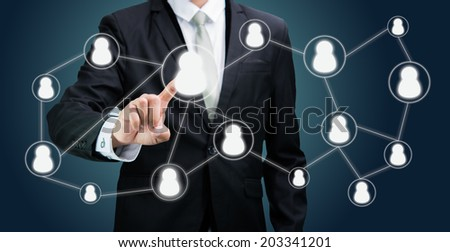 Businessman standing posture hand touching technology concept on dark background - stock photo