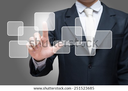 Businessman standing posture hand touching virtual screen isolated on gray background - stock photo