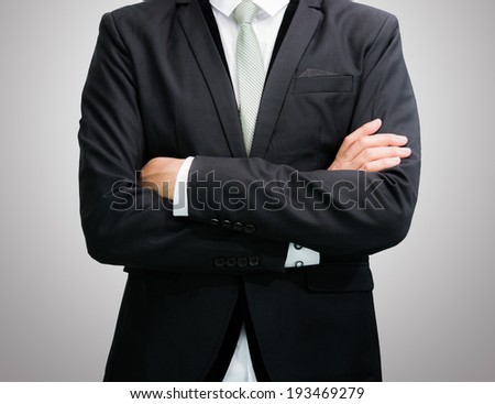Businessman standing posture show hand isolated on over gray background - stock photo