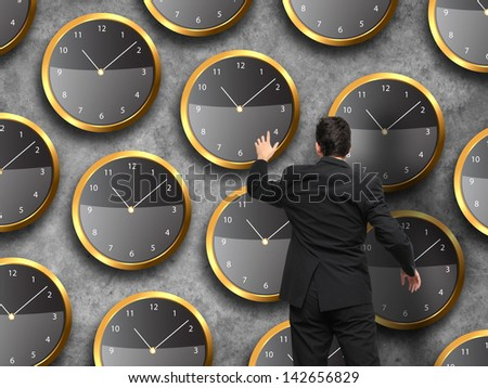 Businessman standing - time strategy concept in color - stock photo