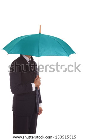 Businessman standing under umbrella.