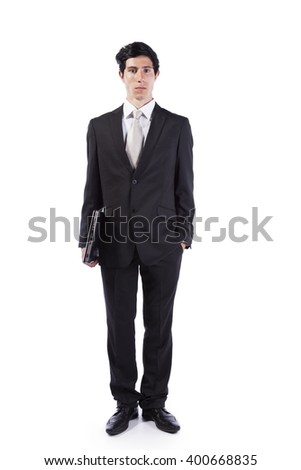 Businessman standing with a laptop (isolated on white)