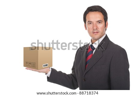 businessman standing with a paper box on his hand - stock photo