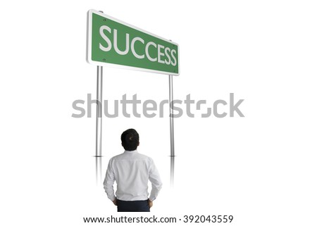 Businessman  standing  with a sign of success - stock photo