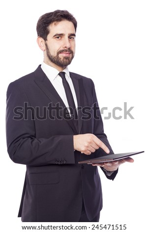Businessman standing with a tablet computer, isolated on a white background - stock photo