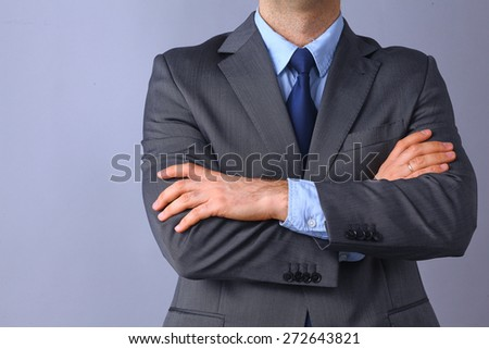 Businessman standing with arms crossed . - stock photo