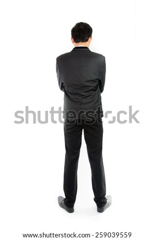 Businessman standing with back isolate on over white background - stock photo