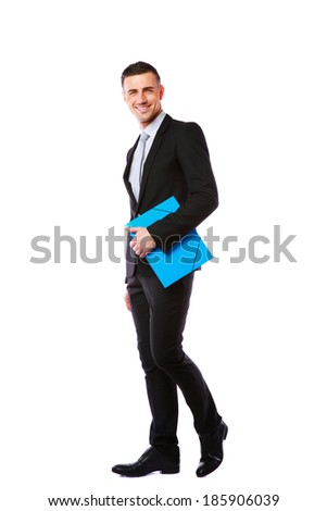 Businessman standing with blue folder in hands over white background