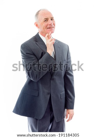 Businessman standing with finger crossed for luck - stock photo