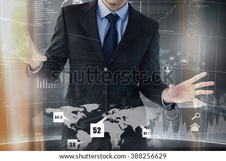 Businessman standing with fingers spread out against futuristic technology interface