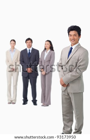 Businessman standing with his associates behind him against a white background