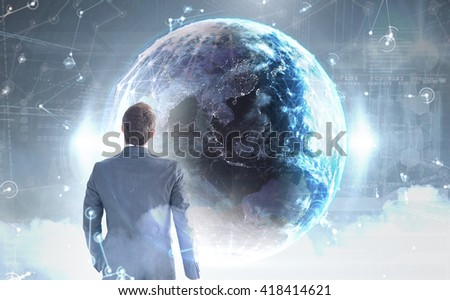 Businessman standing with his briefcase against hologram background - stock photo