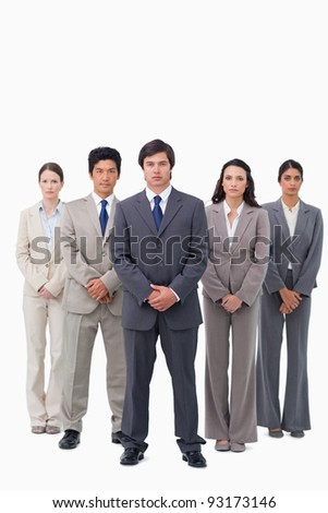 Businessman standing with his team against a white background