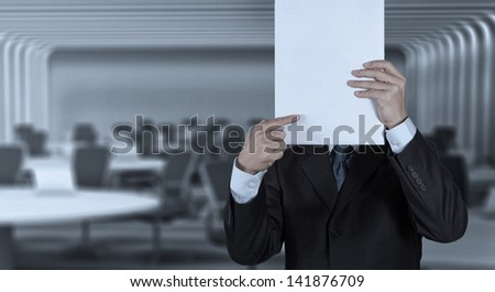 Businessman standing with on blank board as concept - stock photo