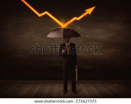 Businessman standing with umbrella keeping orange arrow concept on background - stock photo