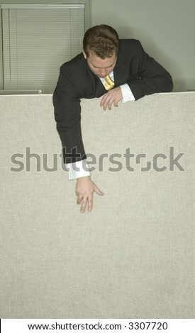 Businessman stands over his cubicle and reaches down to the ground in the office - stock photo