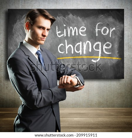 businessman stating that it is time for change - stock photo