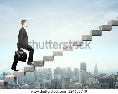 Businessman stepping up a staircase and city - stock photo