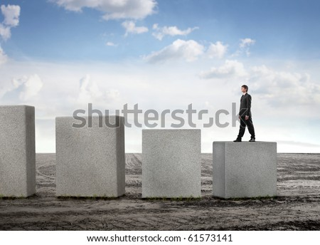 Businessman stepping up some cubes - stock photo