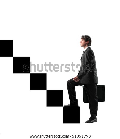 Businessman stepping up the stairs - stock photo