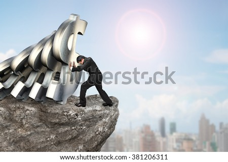 Businessman stopping the falling of dollar currency symbols on cliff, with sunny sky cityscape background.  Domino effect and problem solving of concepts