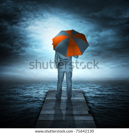 Businessman & Storm at Sea. A businessman watching an storm coming. - stock photo