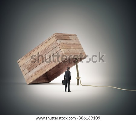 Businessman stranding next to a trap - stock photo